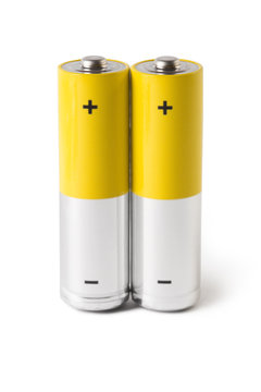 Close-up of two AA batteries, isolated on white background