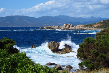 Waves crashing on the rocks at Campomoro shore line, Corsica, France