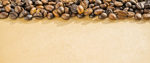 macro of coffee beans on rustic paper background