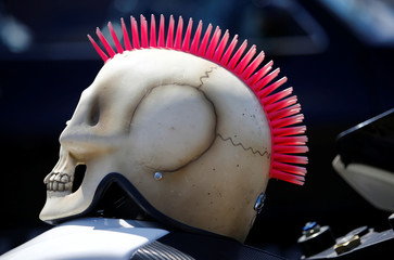 The self-made helmet of motorbike enthusiast Nico Knappe from Berlin sits on the tank of his bike at an  airport racing event in Bottrop-Kirchhellen