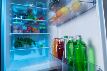 Fully stocked fridge with fresh food and beverages