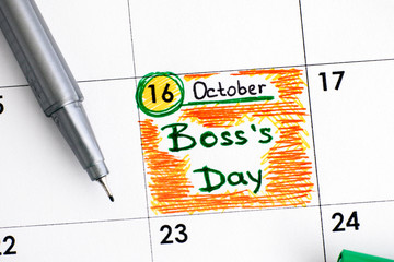Reminder Boss Day in calendar with green pen.