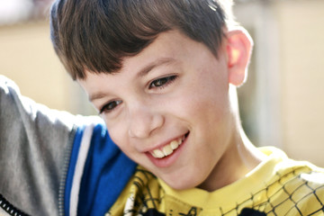 Portrait of a boy smiling outside