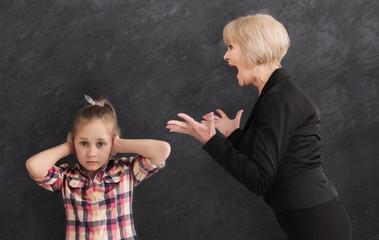 Grandmother arguing her little granddaughter
