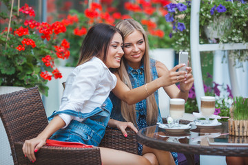 Group of young women making selfie outdoors