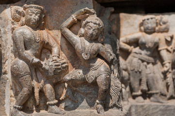 Example of indian artworks from near 12th century, dancers and musician on wall of Hindu temple, Halebidu, India