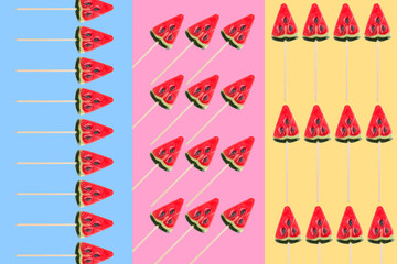 sweets in form of watermelow on pastel blue, yellow and pink background. Minimal flat lay pattern without shadows