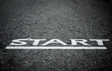 Start letters on asphalt floor with vignette mood and toon, selective focus.