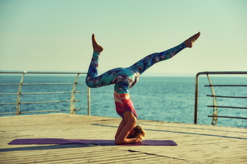 young woman doing yoga outdoors . , morning sports exercises