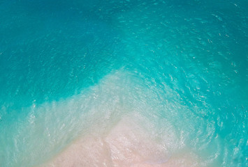 Wall Mural - White sand bank and turquoise ocean from above