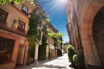 Narrow street of Freiburg im Breisgau at sunny day