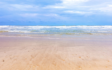 beautiful cleaning beach with cloudy blue sky
