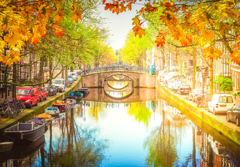 row of bridges over canal with mirror reflections in water at fall, Amstardam, Netherlands Fototapete