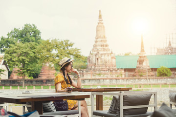 Asian woman with the background of the most famous ancient temple in Ayutthaya.