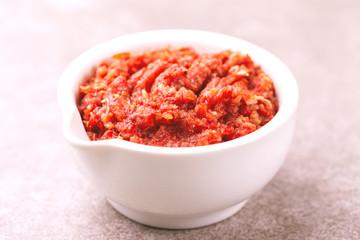 Traditional Maghrebi hot chili pepper sauce paste harissa. adjika