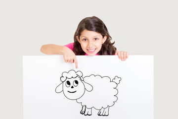 Cute girl showing white board with drawing of sheep - celebrating Eid ul Adha - Happy Feast