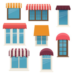 Windows with outside awnings. Architecture elements of the building facades