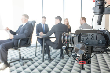 Videographer making video of business people
