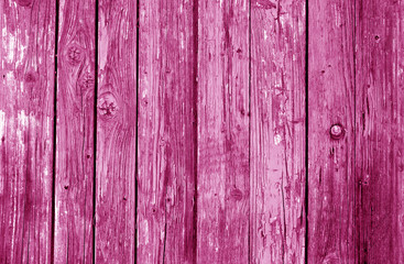 Old grunge wooden fence pattern in pink tone.