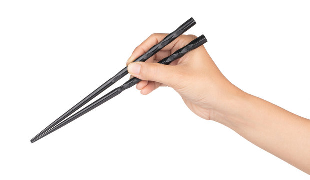 hand holding wood black of chopsticks isolated on a white background