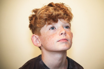 Portrait of a boy looking up