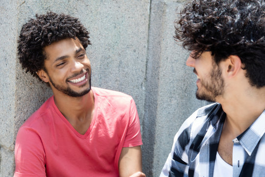 Happy african american man talking with friend