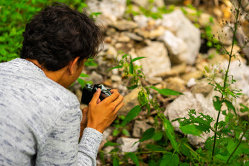 Man Photographing in a forest