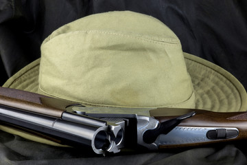 Shotgun and Bush Hat on an Outdoor Coat