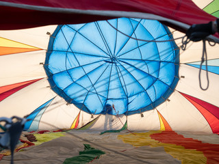 The Shadow of a Person Checking a Hot Air Balloon at It Inflates