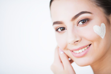 Skincare. Woman With Healthy Face Applying Cosmetic Cream Under The Eyes