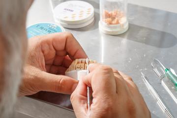 Dental technician applied glaze on ceramic crown