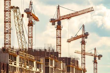 Construction cranes lift cargo. Building construction. Construction crane.