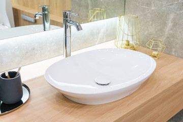 Interior of bathroom with sink basin faucet and mirror. Modern design of bathroom Fototapete