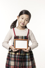 A girl hand hold a photo frame isolated white.