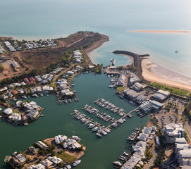 An aerial photo of Cullen Bay, Darwin, Northern Territory, Australia showing marina, residential area and rock wall