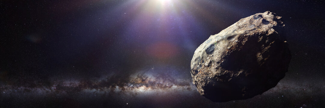 dwarf planet of the asteroid belt lit by Sun and Milky Way galaxy
