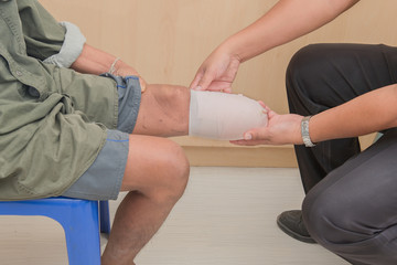 below knee stump bandaging, amputee BKA with prothesis preparing