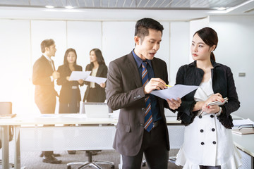 group of successful businessman. Discussion of the business profits of the company in meeting room or conference room.