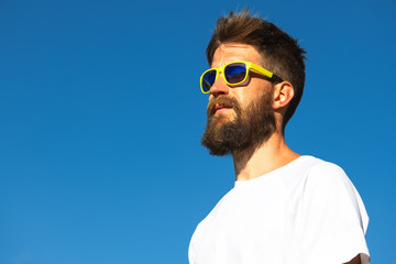 Portrait of sporty man with beard and yellow glasses