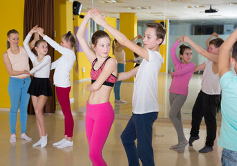 Teenagers in pairs learning active boogie-woogie