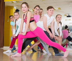 Happy teenagers in dance studio