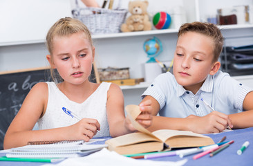 Brother with sister are doing homework