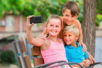 Kids are taking selfie on phone
