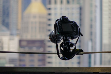 A DSLR camera in front of modern buildings