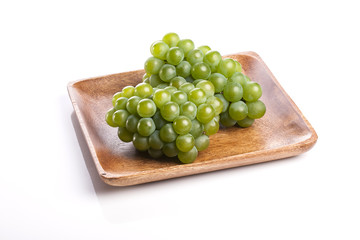 green grapes on the white background.