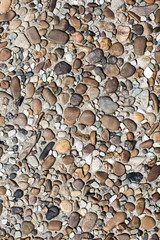 fragment of surface with decorative filling with sea pebbles