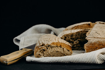 Freshly baked bread and knife. Rural kitchen or bakery.