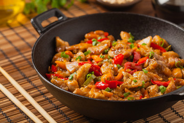 Chicken kung pao. Fried chicken pieces with peanuts and peppers.