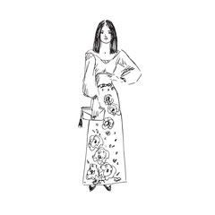 Glamorous fashion model in long skirt with flowers print and blouse standing, front view, hand drawn ink doodle, sketch, outline black and white vector fashion illustration