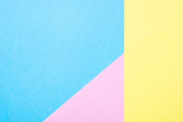 Blue, yellow and pink paper background.